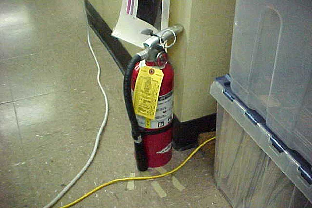 electrical-cords-trip-hazard-and-fire-extinguisher-unmounted